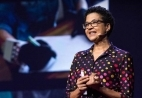 Portrait of Prof Tania Douglas on stage durign her TED talk